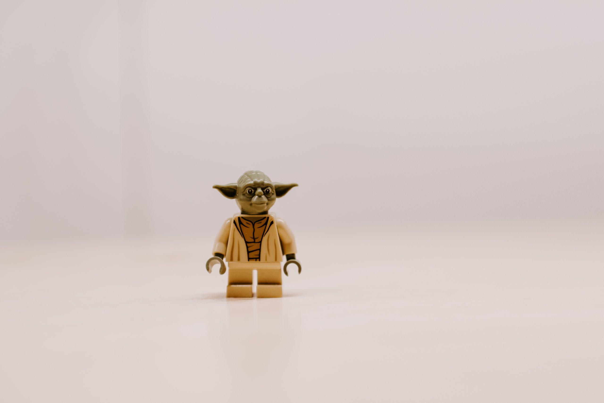 Lego yoda on white background.