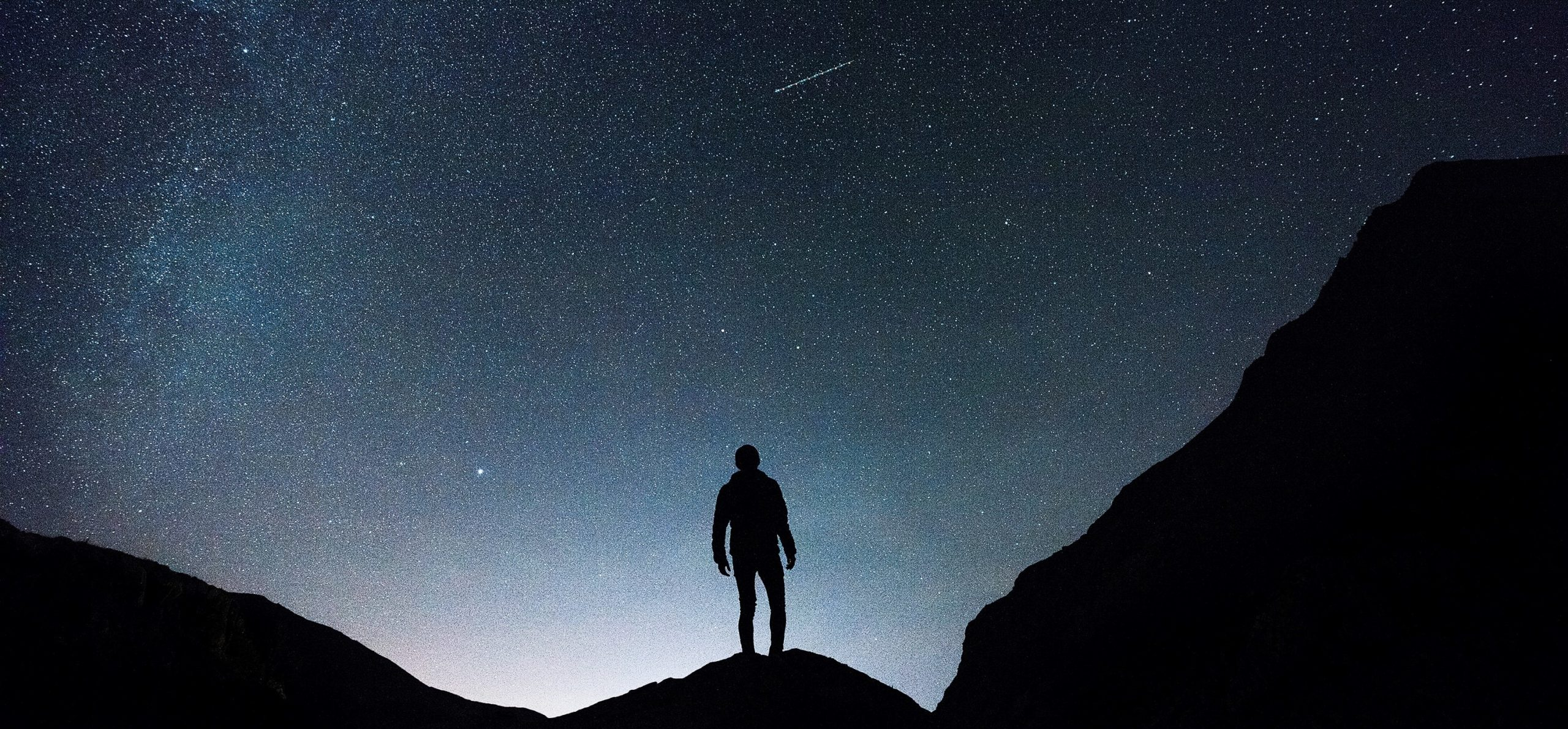 person stood in front of dark sky to represent The struggle of being an Agile perfectionist.